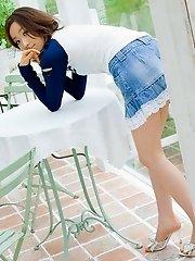 Cute Asian teen model in a mini skirt