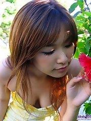 Cute Asian model likes posing on the beach