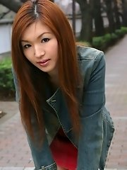 Asian beauty in a mini skirt shows her ass