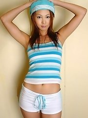 Cute Asian babe removes her top to flash tits