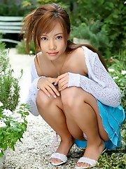Lovely Asian model poses in the sun