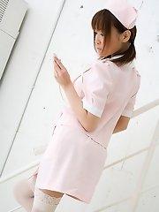 Pretty Asian nurse in stockings