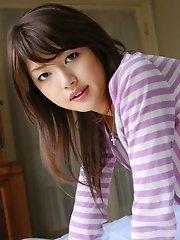 Adorable Asian model Erika enjoys cameras