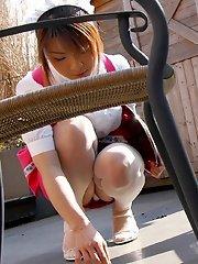 Slutty Japanese server shows off her lingerie
