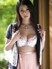 Mature and sexy Japanese av idol Nana Aida shows her perfect body outdoors