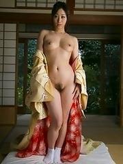 Mature and beautiful Japanese av idol Yu Kawakami shows her naked body after taking off her kimono