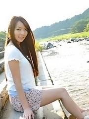 Beautiful and horny Japanese av idol Jessica Kizaki lays down to show her sexy body