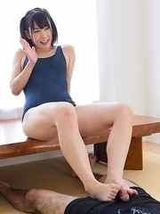 Dark-haired beauty Yui Kasugano using her sexy feet to make a guy explode all over