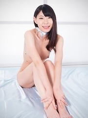 Smiling seductress Aki Tojo shows off her toes and gives a great footjob on cam