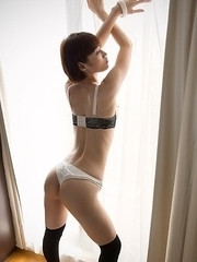 Mizuki poses in her lingerie in a sun-lit room before stripping naked for you