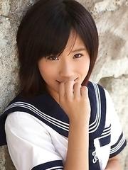 Japan teen Yuzuki Hashimoto in sailor gal uniform is playful outdoor