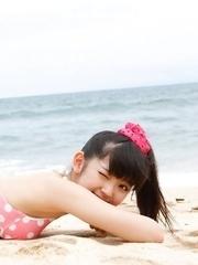 Airi Suzuki in cute bath suit enjoys hot sand on her curves