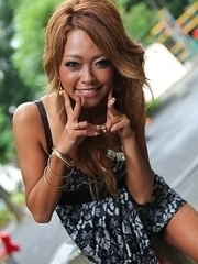 Asian Rei Miyakawa in a sexy dress is playful