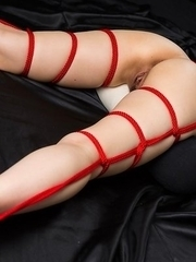 Sexual teasing of Minami Sakaida's wet pussy during a shibari bondage session